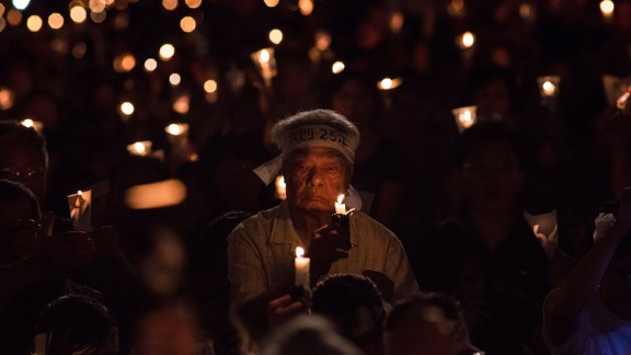 People take part in a candlelight vigil to commemorate the June 4, 1989 incident in Tiananmen Square that saw hundreds of protesters killed by the Chinese military.