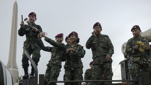 """Thai soldiers entertain people with songs at Victory Monument in Bangkok on Thursday, June 5. The junta is waging a propaganda campaign to encourage """"national happiness"""" following the coup that severely restricted civil liberties."""