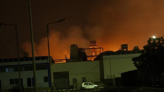 Fire illuminates the sky above a terminal at the  airport, Pakistan