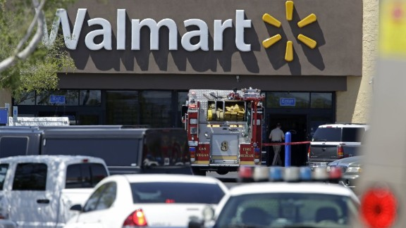 Police and firefighters on the scene of the shooting at a Las Vegas Walmart, on Sunday, June 8. Two gunmen shot and killed two police officers eating lunch and then killed a third person at the Walmart. The gunmen then killed themselves.