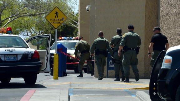 Police officers move to enter the Walmart.