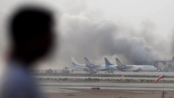 Smoke rises from Jinnah International Airport on Monday, June 9.