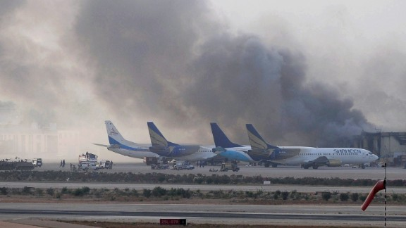 Smoke rises after militants launched an early morning assault at Jinnah International Airport in Karachi on June 9, 2014. Pakistan's security forces said on June 9 they have relaunched a military operation at Karachi airport as gunfire resumed several hours after they announced the end of a militant siege that left 24 dead. AFP PHOTO / Rizwan TABASSUM (Photo credit should read RIZWAN TABASSUM/AFP/Getty Images)
