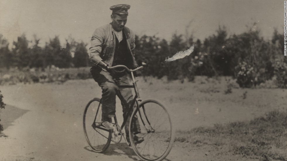 German man riding a bicycle using prostheses on both arms and legs. Photo by Dr. P. A. Smithe, American Red Cross surgeon at the Vienna Red Cross Hospital, 1914-1915.