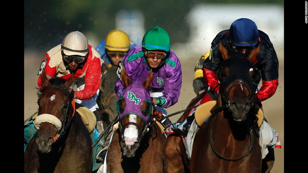 Victor Espinoza, wearing purple, rides California Chrome down the backstretch during the Belmont. California Chrome won the Kentucky Derby and the Preakness earlier this year but ultimately failed in his quest to become the first Triple Crown winner since 1978.