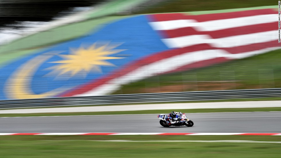 Alex Lowes speeds past a Malaysia flag Friday, June 6, during practice for the Superbike World Championship race in Sepang, Malaysia.