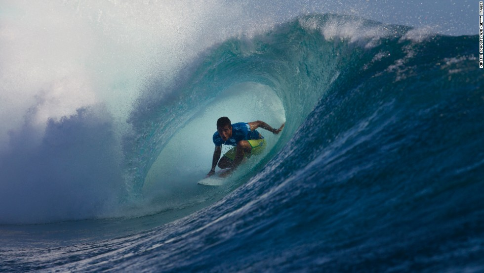 Surfer Filipe Toledo ducks under a wave Wednesday, June 4, at the Fiji Pro competition in Tavarua, Fiji. Gabriel Medina won the event, beating Nat Young in the final.