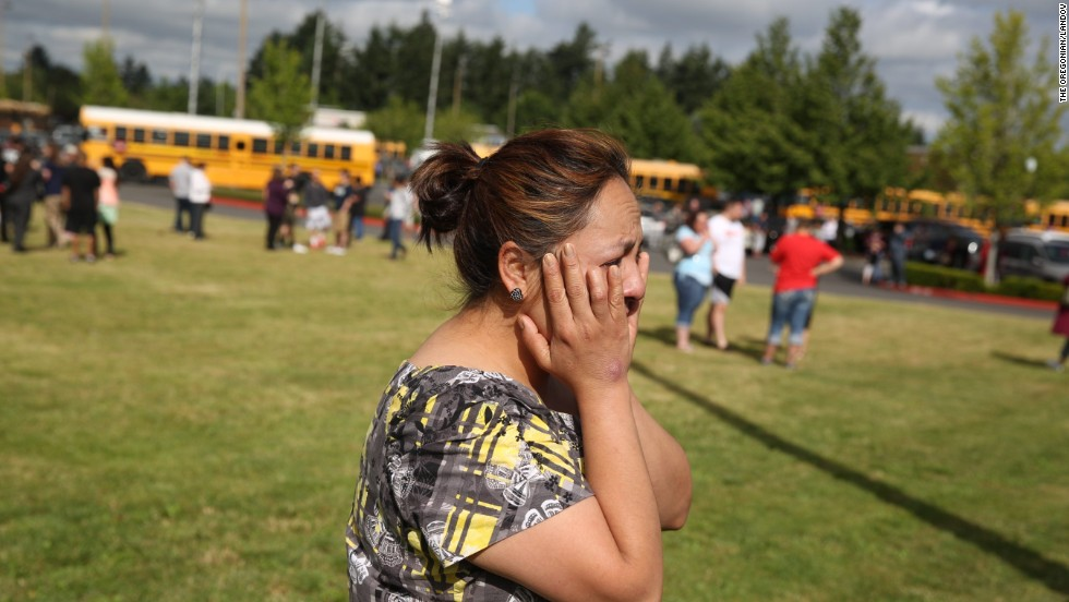 A distraught woman waits for news after the school shooting June 10.