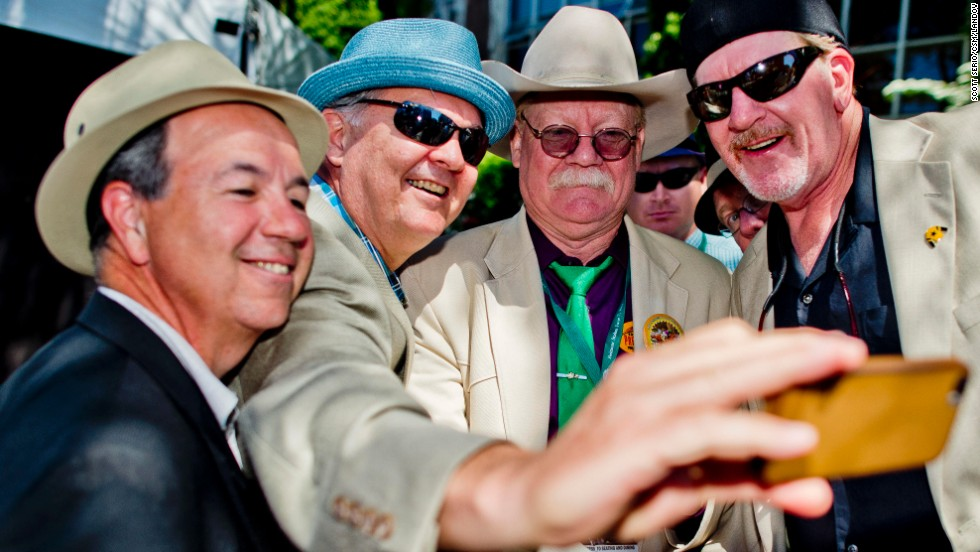 California Chrome co-owner Steve Coburn (second from right) poses for a photo with fans prior to the Belmont Stakes in June -- the final leg of the Triple Crown.