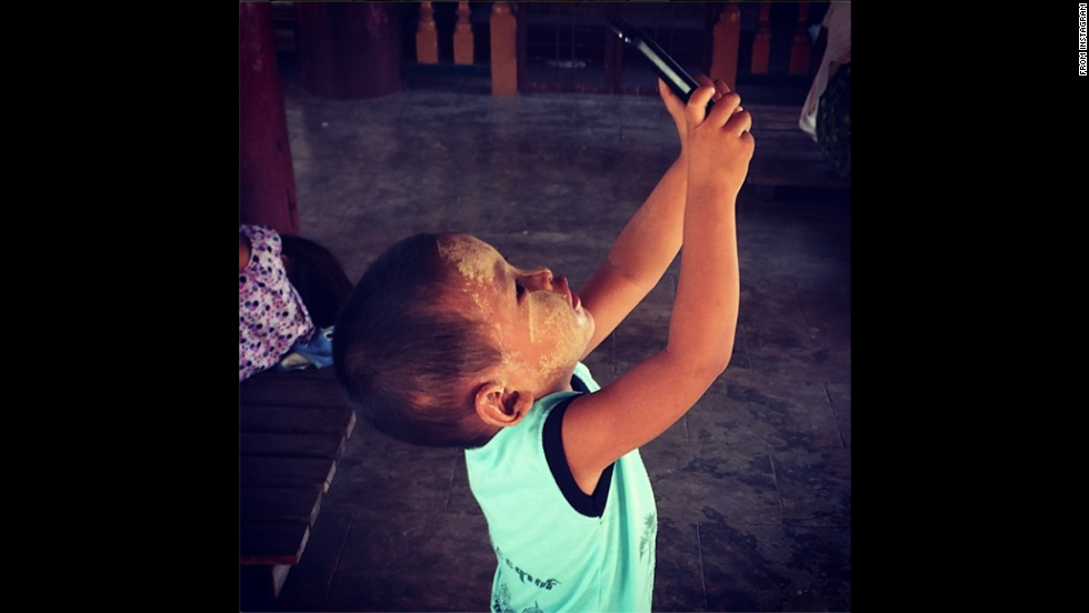 "CNN producer Mitra Mobasherat <a href=""http://instagram.com/p/o5DCH9sHkh/"" target=""_blank"">snapped this photo</a> of a young boy taking a selfie Friday, June 6, while his mother and grandmother prayed at a Buddhist temple in Bagan, Myanmar."