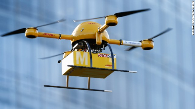 BONN, GERMANY - DECEMBER 09:  A quadcopter drone arrives with a small delivery at Deutsche Post headquarters on December 9, 2013 in Bonn, Germany. Deutsche Post is testing deliveries of medicine from a pharmacy in Bonn in an examination into the viability of using drones for deliveries of small packages over short distances. U.S. online retailer Amazon has also started its intention to explore the possibilities of using drones for deliveries.  (Photo by Andreas Rentz/Getty Images)