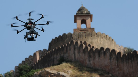 "A drone fitted with a film camera shoots aerial footage during the production of the film ""The Girl with the Indian Emerald"" in Jaipur, India, on November 7, 2012. While it's already being done in other countries, the U.S. government is considering a request from movie and TV producers to let them use unmanned aircraft to shoot aerial video."
