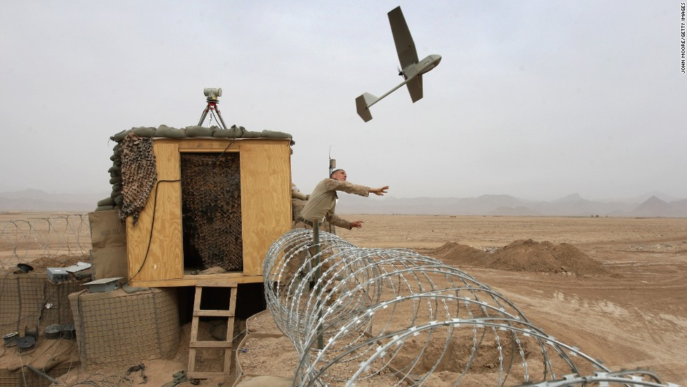 U.S. Marine Sgt. Nicholas Bender launches a Raven surveillance drone from Marine base near the remote village of Baqwa, Afghanistan, on March 21, 2009. Marines use the unmanned aerial vehicles to get real-time intelligence on Taliban movements.