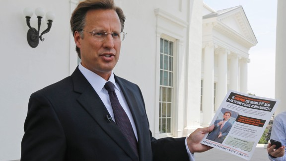 Seventh District US Congressional Republican candidate, David Brat displays an immigration mailer by Congressman Eric Cantor during a press conference at the Capitol in Richmond, Va., Wednesday, May 28, 2014. Brat challenged Congressman Eric Cantor's stand on immigration, claiming that Cantor backs amnesty. Cantor is getting pressured from both sides over immigration as his Republican primary election nears and the window for legislative action narrows.   (AP Photo/)
