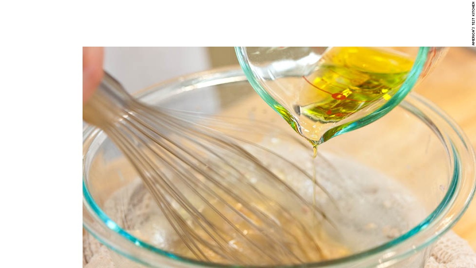 5. Whisking constantly, very slowly drizzle oil into vinegar mixture.