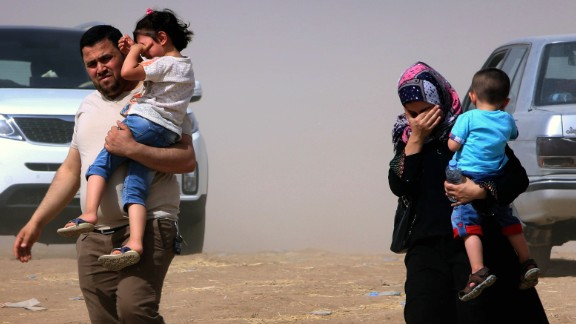 An Iraqi family fleeing violence in the northern Nineveh province arrives at a Kurdish checkpoint in Aski kalak, 40 kms West of Arbil, in the autonomous Kurdistan region, on June 11, 2014. Since the Islamic State of Iraq and the Levant began their spectacular assault in Mosul late on June 9, militants have captured a large swathe of northern  and north-central Iraq, prompting as many as half a million people to flee their homes. AFP PHOTO/SAFIN HAMED        (Photo credit should read SAFIN HAMED/AFP/Getty Images)