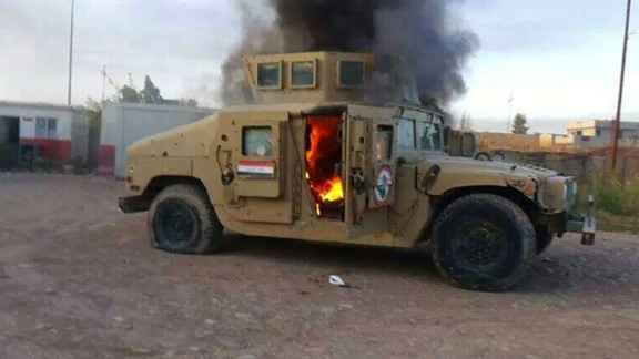 A picture taken with a mobile phone shows an armoured vehicle belonging to Iraqi security forces in flames on June 10, 2014, after hundreds of militants from the Islamic State of Iraq and the Levant (ISIL) launched a major assault on the security forces in Mosul, some 370 kms north from the Iraqi capital Baghdad. Some 500,000 Iraqis have fled their homes in Iraq's second city Mosul after Jihadist militants took control, fearing increased violence, the International Organization for Migration said. AFP PHOTO/STR (Photo credit should read STR/AFP/Getty Images)