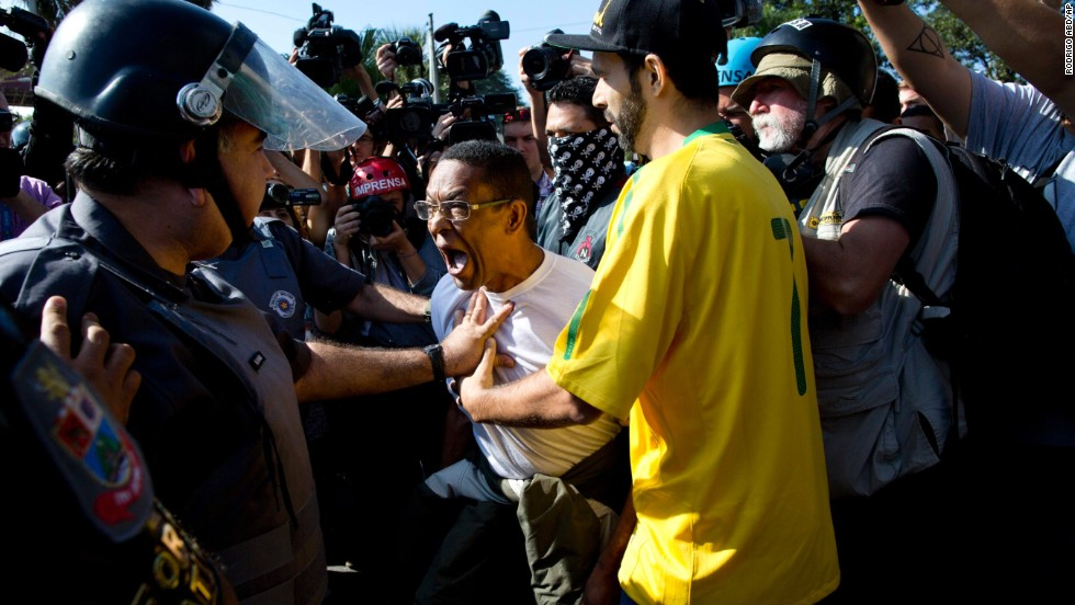 A protester argues with police during the Sao Paulo demonstration on June 12.