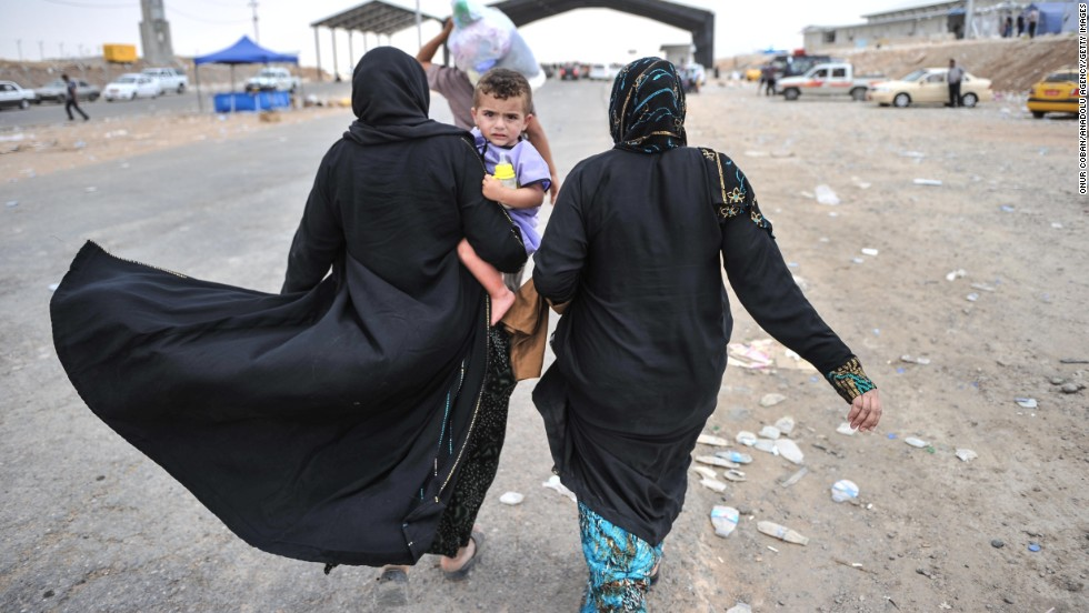 Iraqi civilians from Mosul escape to a refugee camp near Erbil, Iraq, on Thursday, June 12. More than 500,000 people fled in fear after extremist militants overran Mosul, Iraq's second-largest city, on June 10, the International Organization for Migration said.