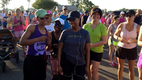 """Evans, left, says somewhere along her journey, she """"fell in love with running."""" Here, she participates in the Red River Road Runners Summer Fun Run on June 5, weighing 125 pounds."""
