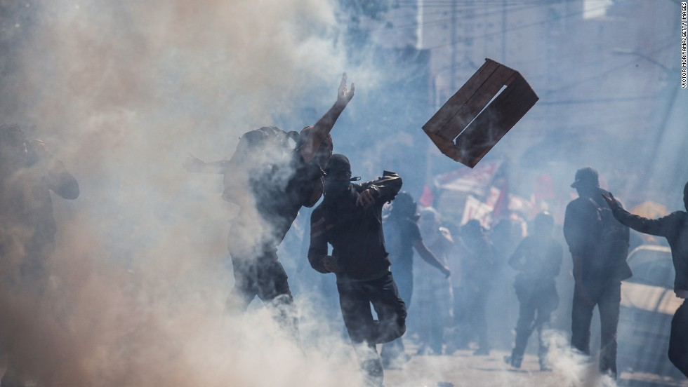 Demonstrators clash with police during the protest.