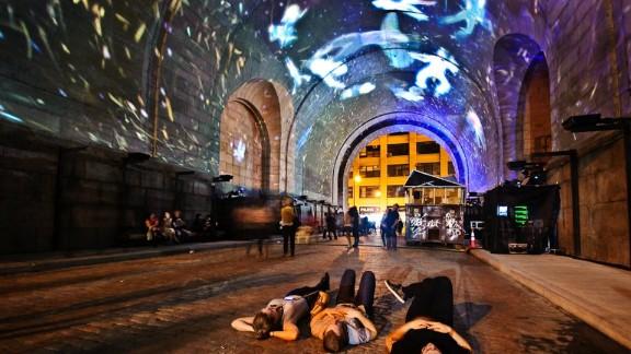 The Manhattan Bridge project was a collaboration of artists Ryan Uzilevsky, Farkas Fülöp, Simon Anaya, Sina Taherkhani , John Ensor Parker, Johnny Moreno and Richard Jochum.