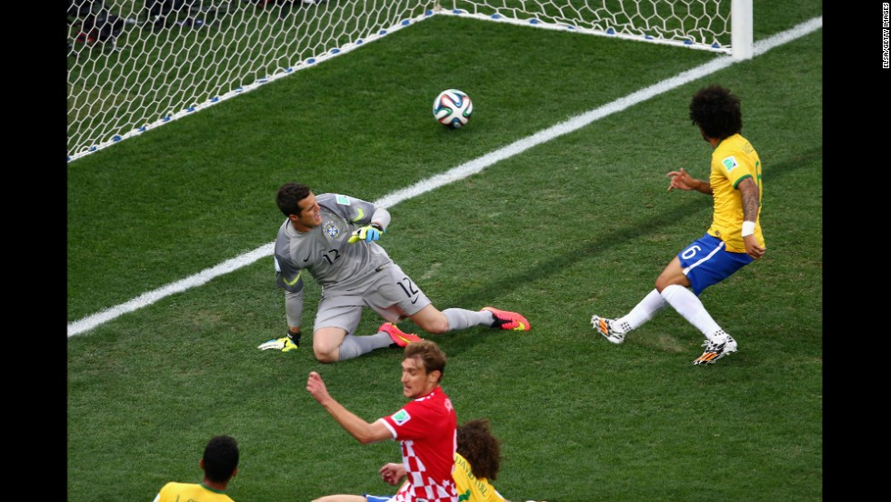 "Marcelo, right, accidentally deflects the ball past his own goalkeeper, Julio Cesar. It was the <a href=""http://www.cnn.com/2014/06/12/football/gallery/world-cup-goals/index.html"">first goal of the match</a> and put the hosts in an early hole. <a href=""http://www.cnn.com/2014/06/12/football/gallery/world-cup-goals/index.html"">See all the goals from the World Cup</a>"