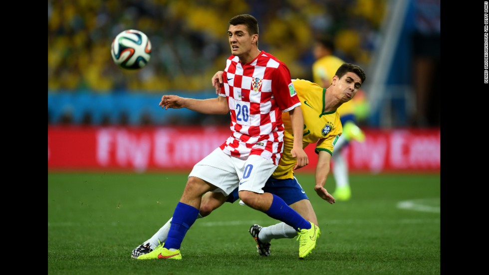 Croatia's Mateo Kovacic, left, is challenged by Oscar.
