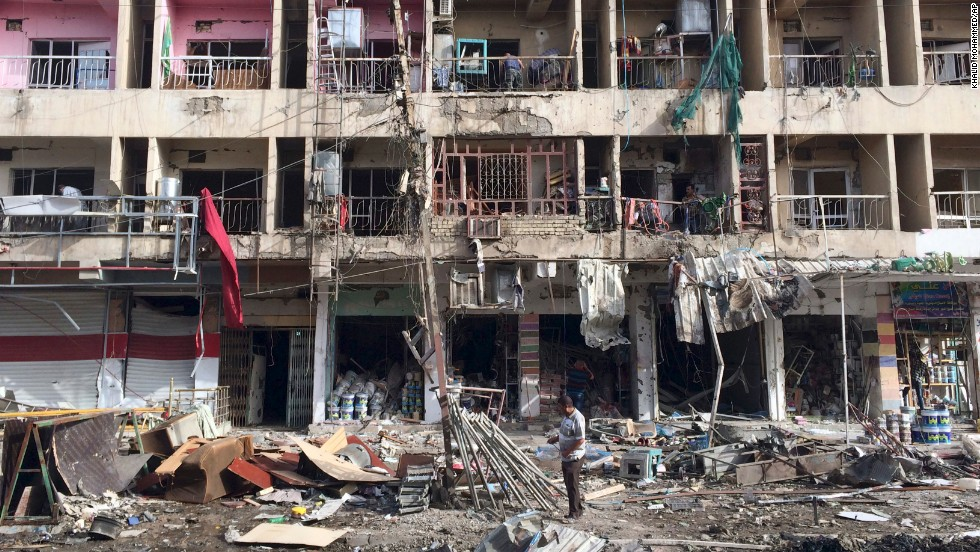 "Iraqi civilians inspect the aftermath of a car bombing Sunday, June 8, in Baghdad. A series of car bombs exploded across the capital the day before, killing at least 33 people and injuring 72 others, police officials said. <a href=""http://www.cnn.com/2014/06/07/world/meast/iraq-attacks/index.html"">The explosions</a> occurred in a busy commercial Shiite neighborhood, targeting mostly civilians, police said."