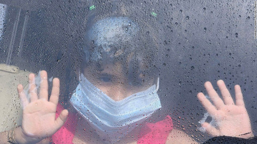 "A girl wearing a surgical mask looks out a car window Saturday, June 7, as raindrops are seen in Taif, Saudi Arabia. The country has reported <a href=""http://www.cnn.com/2014/06/03/health/mers-outbreak/index.html"">hundreds of cases of the MERS virus</a> since it first surfaced there in spring 2012. Many of the cases have resulted in death."