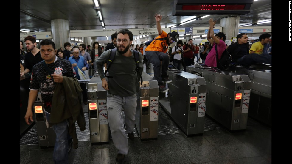 "Some demonstrators jump over turnstiles without paying for subway fare Monday, June 9, in Sao Paulo, Brazil. The buildup to the World Cup has been plagued by <a href=""http://www.cnn.com/2014/06/12/world/gallery/world-cup-protests/index.html"">mass demonstrations</a> over the estimated $11 billion cost of staging the soccer tournament. Many protesters, angered by the state of Brazil's public services, believe the money would be better spent elsewhere."