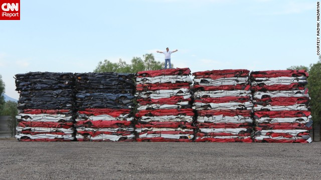 Talk about patriotism, Razmik Nazaryan made this colossal American flag rendition with 108 crushed cars. The artist works in auto recycling and was inspired to create his masterpiece back in July 2013.