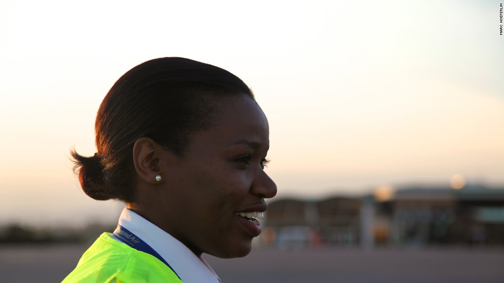 "As Rwanda's first female commercial pilot, Esther Mbabazi wants women to realize they can do anything. ""Time has changed. Women are out there working, technology has changed, and everyone has the brains to do something, now it's not about how much bicep or how much energy you have."""
