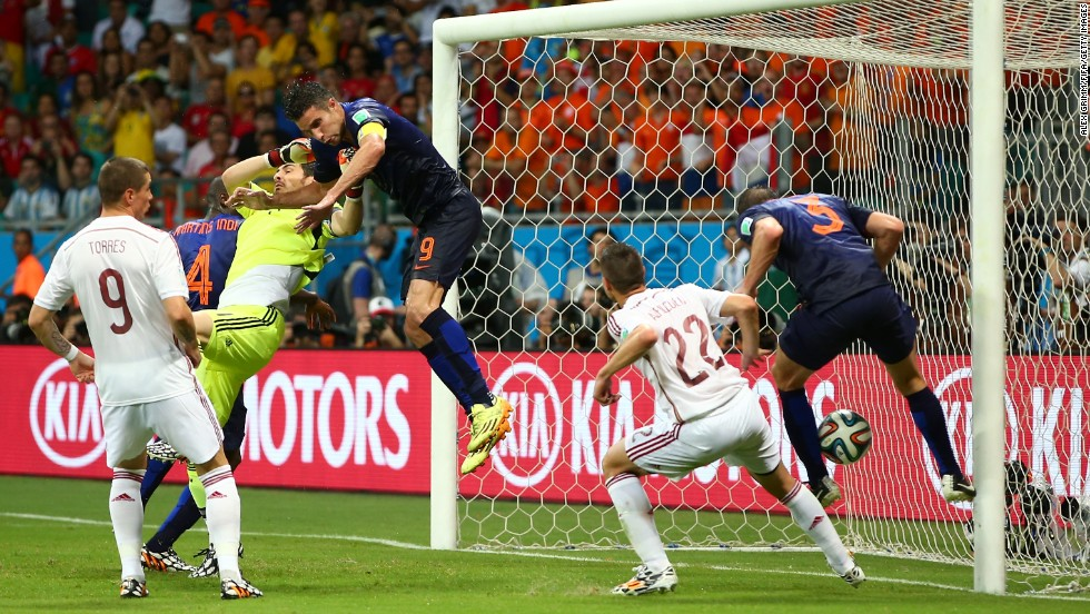 Stefan de Vrij, right, deflects the ball in for the Netherlands' third goal while van Persie collides with Spanish goalkeeper Iker Casillas.
