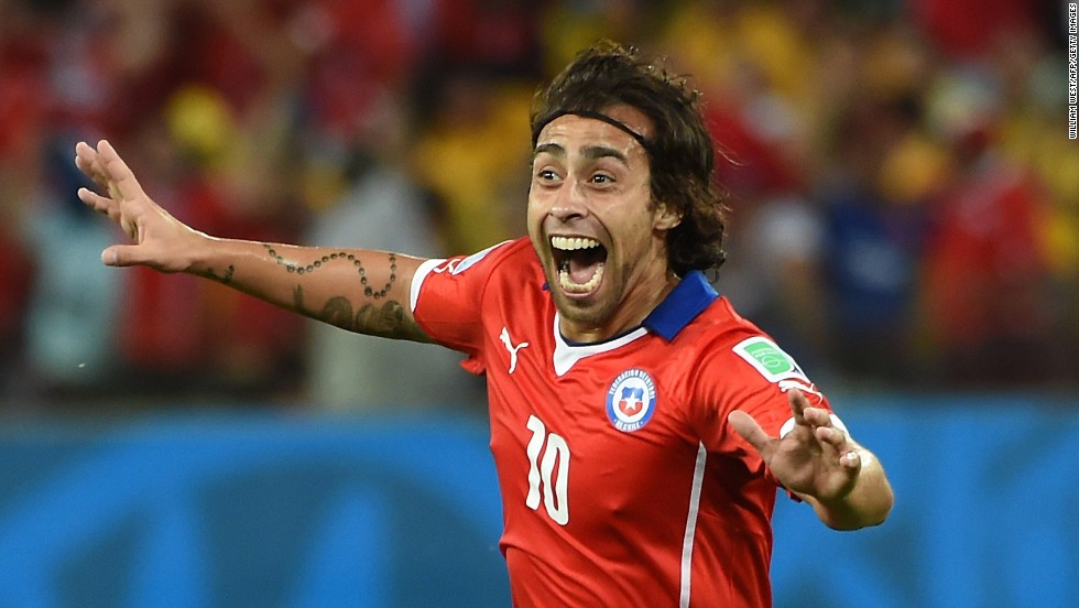 Chile's Jorge Valdivia shows his excitement after scoring a goal that gave his team a 2-0 lead in its World Cup game against Australia on Friday, June 13. Chile won the game 3-1.