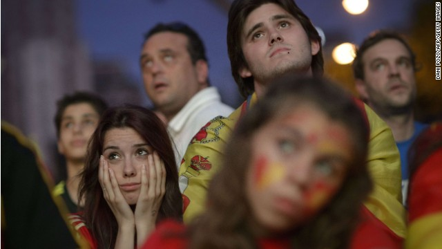 Spain's supporters react while watching the 2014 FIFA World Cup football match between Spain and Netherlands on a giant screen near the Santiago Bernabeu stadium in Madrid on June 13, 2014.