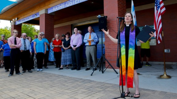 Pastor Carol Hill from Epworth United Methodist Church speaks during a marriage-equality ceremony at the Kathy Osterman Beach in Chicago on June 1, 2014. The date marked the first day that all of Illinois' 102 counties could begin issuing marriage licenses to same-sex couples.