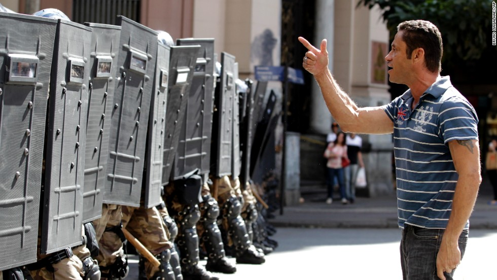 A demonstrator argues with police during a protest against the World Cup in Belo Horizonte, Brazil, on Saturday, June 14. The buildup to the World Cup has been plagued by mass demonstrations over the estimated $11 billion cost of staging the football tournament. Many protesters, angered by the state of Brazil's public services, believe the money would have been better spent elsewhere.