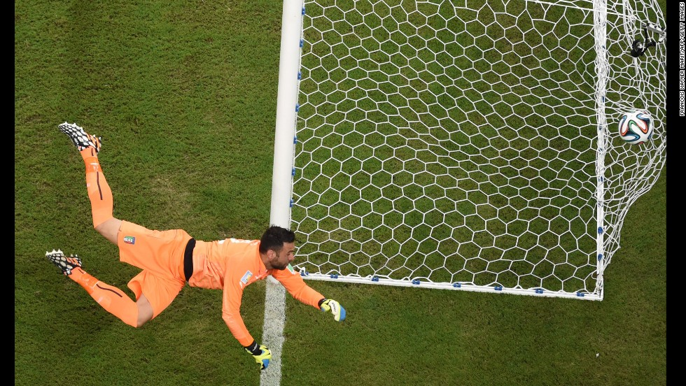 Italy goalkeeper Salvatore Sirigu sees an early England shot fly into the sidenetting.