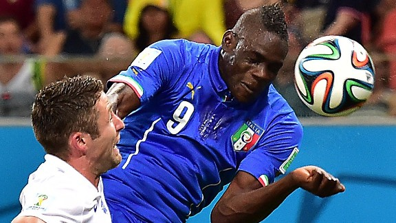 Italy's forward Mario Balotelli (R) scores the winner against Group D opponents England.