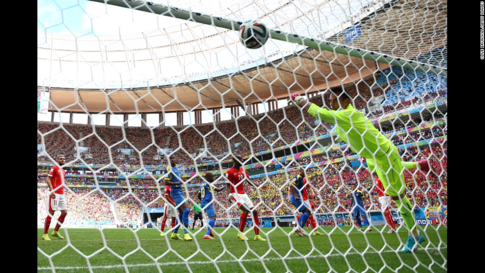 Enner Valencia, second left, scores for Ecuador against Switzerland, heading a corner past keeper Diego Benaglio.