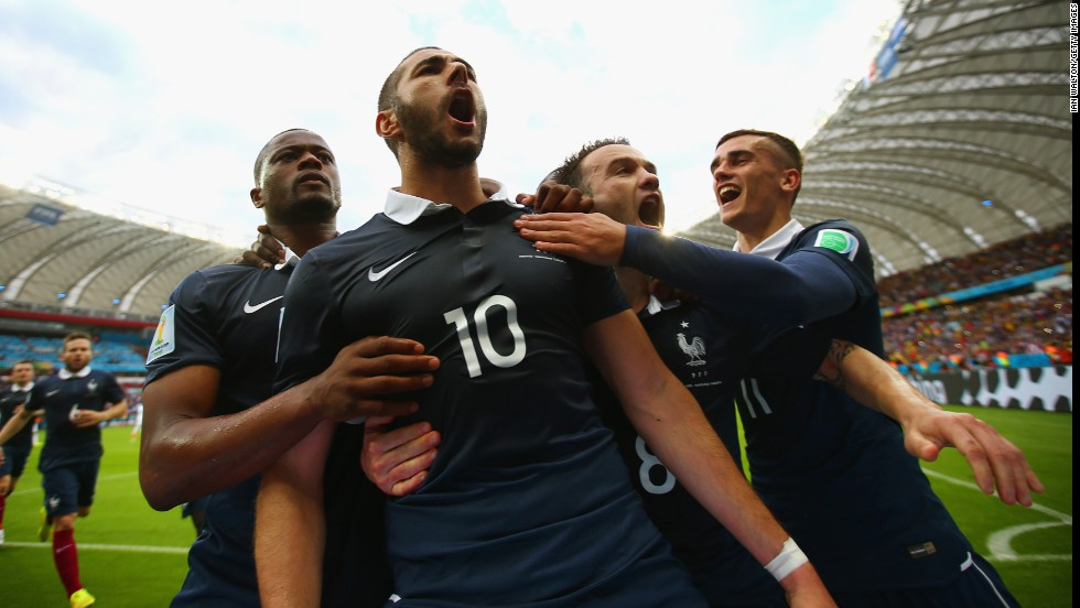 "France forward Karim Benzema, second left, celebrates with teammates after scoring his <a href=""/2014/06/12/football/gallery/world-cup-goals/index.html"" target=""_blank"">team's first goal</a> against Honduras with a penalty kick."