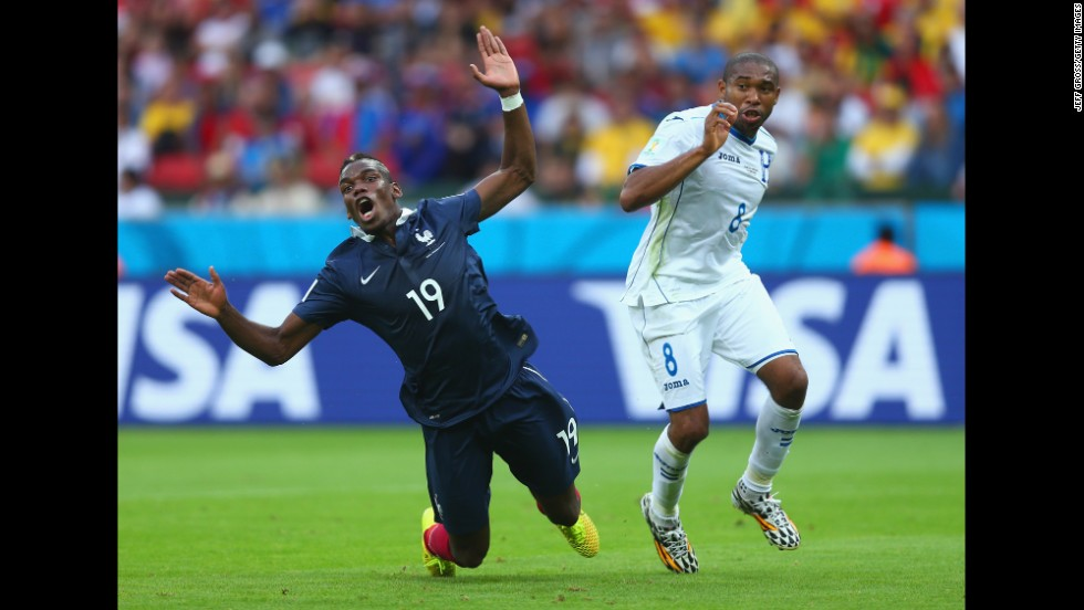 Wilson Palacios of Honduras fouls Paul Pogba of France, resulting in a penalty kick.