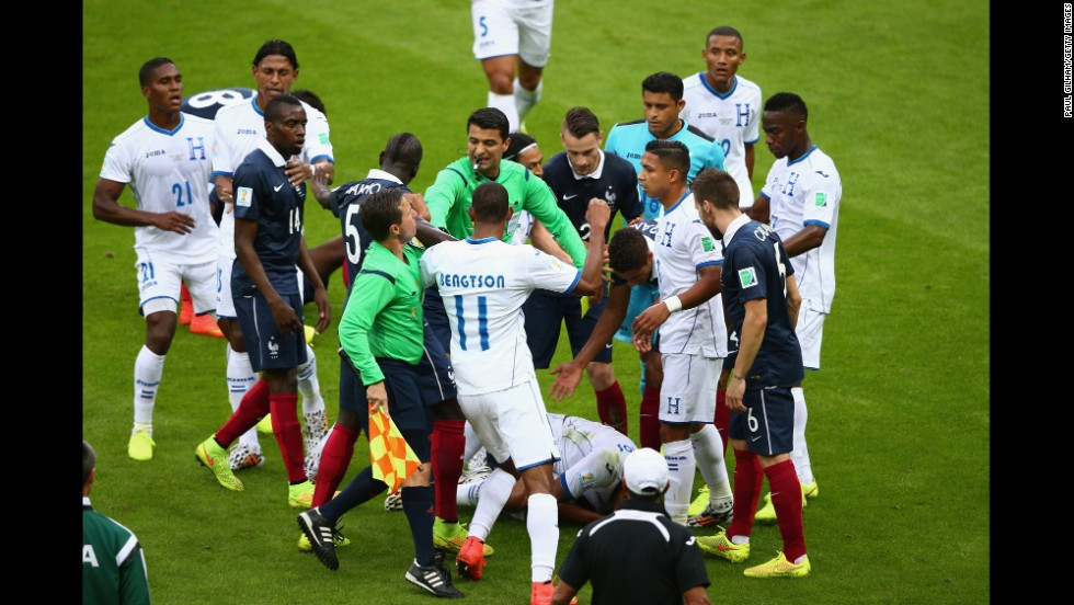 Wilson Palacios of Honduras lies on the field receiving treatment as referee Sandro Ricci tries to restore order.