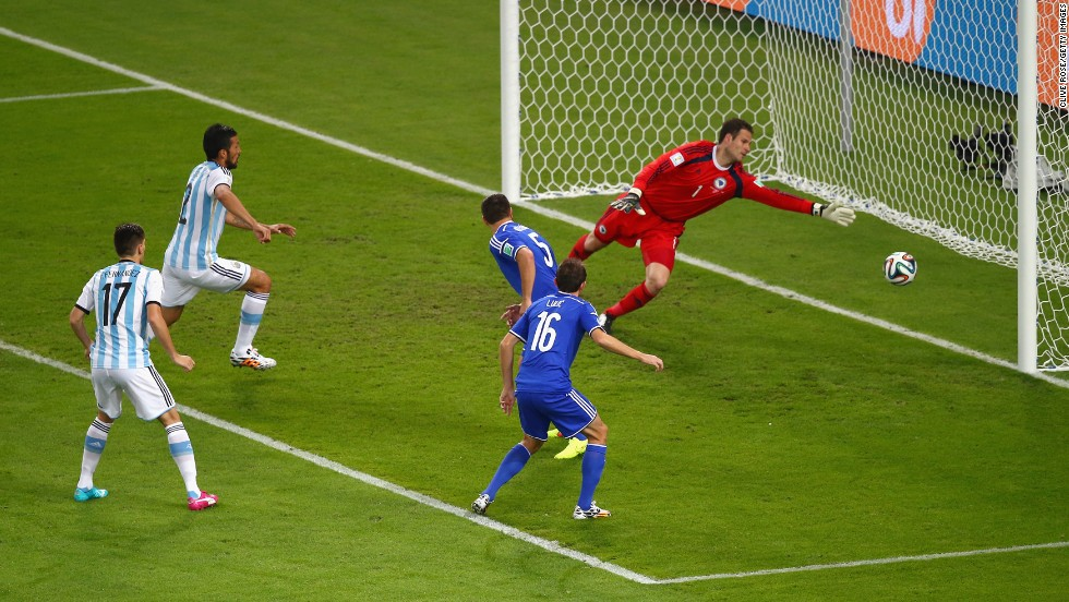 Sead Kolasinac of Bosnia and Herzegovina scores an own goal past goalkeeper Asmir Begovic as Ezequiel Garay and Federico Fernandez of Argentina look on.
