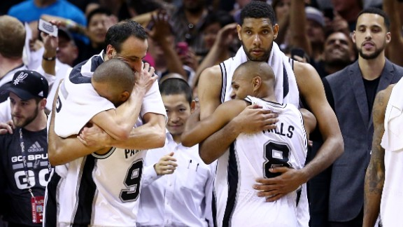 San Antonio Spurs celebrate in the closing minutes of Game 5 of the 2014 NBA Finals against the Miami Heat.