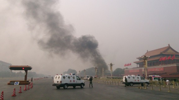 Police cars block off the roads leading into Tiananmen Square as smoke rises into the air after a vehicle crashed in front of Tiananmen Gate in Beijing on October 28, 2013. Three people were killed when an SUV vehicle crashed into a crowd in Beijing's Tiananmen Square and burst into flames, state media said, as pictures showed a tower of smoke rising before the Forbidden City. TOPSHOTS CHINA OUT AFP PHOTO (Photo credit should read STR/AFP/Getty Images)