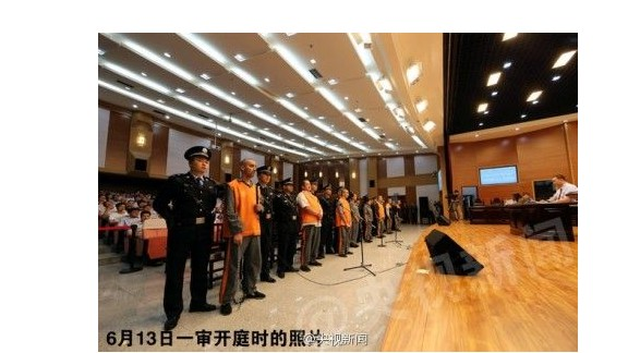 The sentenced people in a Urumqi courtroom. Photo from CCTV.