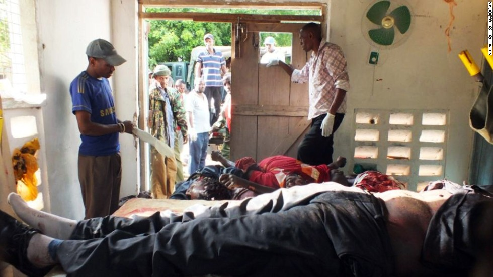 Bodies of victims are gathered in Mpeketoni on June 16. The group of attackers entered the town center and began killing people before moving into a residential area where they moved door to door.