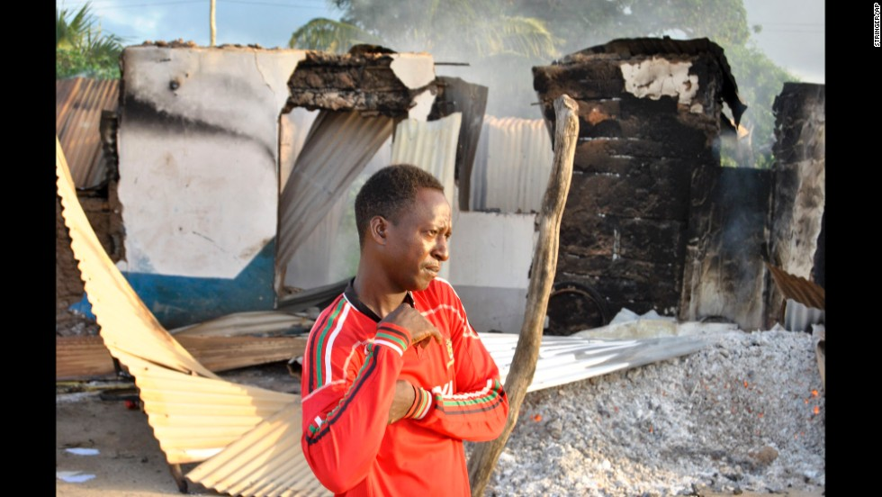 A man stands in front of a destroyed building in Mpeketoni on June 16.